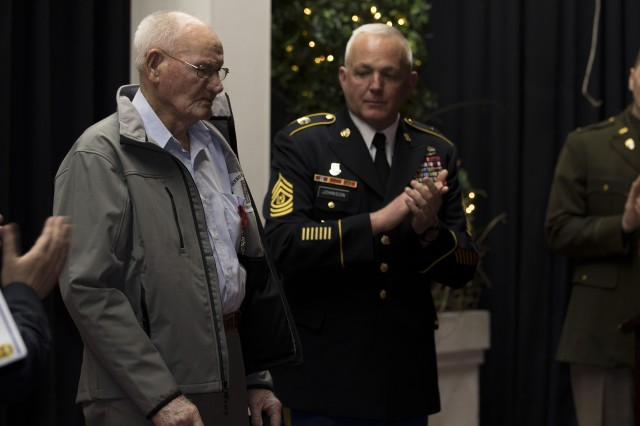 Jack baker, left, was officially presented the National Order of the Legion of Honour, more than 70 years after returning home from World War II. Baker served with the First United States Army during the war and was part of every one of the unit's historic accomplishments during that time. When Baker returned home in 1945, he quietly went back to work and went on with his life as husband, father and grandfather in his hometown of Olive Hill, Ky. In a ceremony hosted by Lt. Gen. Stephen Twitty, commanding general of First Army, Baker -- surrounded by family, friends, neighbors and representatives from local, state, federal and the French government -- received the recognition he never sought but always deserved. (U.S. Army photo by Sgt. 1st Class Darron Salzer, First Army Division East)