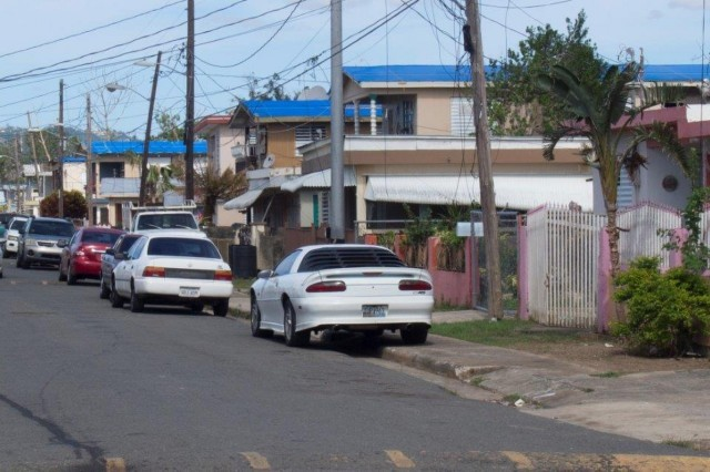 Contractors working for the U.S. Army Corps of Engineers installed the last temporary blue roof today in Puerto Rico, for residences damaged by hurricanes Irma and Maria, bringing the total roofs complete to 59,469. Operation Blue Roof is a program managed by the U.S. Army Corps of Engineers on behalf of FEMA that provides temporary, plastic-sheeting roofs to eligible homes until permanent repairs can be made. The temporary roofs are designed to last approximately 30 days. Shown: Temporary blue roofs as seen in Mayagüez, Puerto Rico, Dec. 30. (Photo by Staff Sgt. Eric W. Jones)