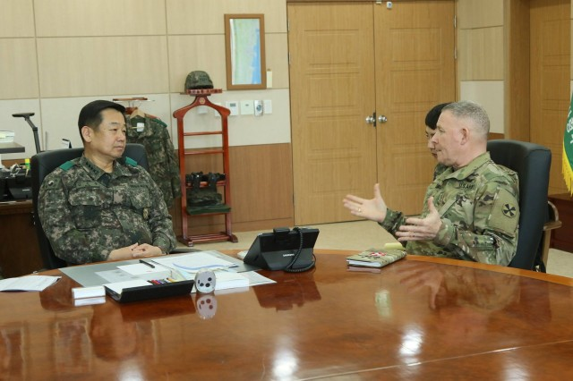 Lt. Gen. Michael A. Bills, Eighth Army commanding general, conducts an office call with Gen. Kim, Woon Yong, TROKA commanding general during a visit with the Third Republic of Korea Army, Yong-in, South Korea, Mar. 22.