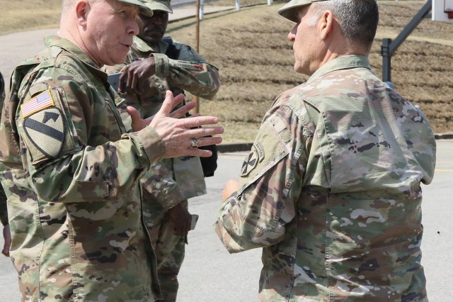 Lt. Gen. Michael A. Bills, Eighth Army commanding general, and Command Sgt. Maj. Richard E. Merritt, Eighth Army command sergeant major, speak with each other during a visit to the 2501st Digital Liaison Detachment, Yong-in, South Korea, Mar. 22.
