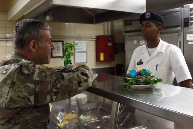 Command Sgt. Maj. Richard E. Merritt, Eighth Army command sergeant major, meets with Eighth Army Soldiers during a visit with the 2501st Digital Liaison Detachment, Yong-in, South Korea, Mar. 22. Merritt toured the facilities in the garrison to check the living conditions of the Soldiers.