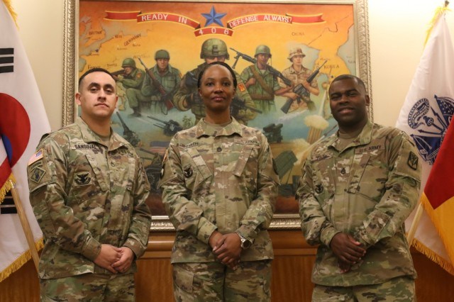 Master Sgt. Peggy A. Smith, center, senior career counselor for 35th Air Defense Artillery Brigade, with Staff Sgt. Alan I. Sandoval, left, career counselor for 2-1 ADA Battalion and Staff Sgt. Derrick C. Davis, right, career counselor for 6-52 ADA Battalion, stand for a group photo at the 35th ADA Brigade Headquarters March 20, 2018, at Osan Air Base, South Korea.The trio helped 20 35th ADA Brigade Soldiers sign reenlistment contracts totaling more than half a million dollars over a three month period, December 2017 - February 2018, to keep Soldiers in Army greens and help many erase personal debt.