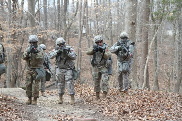 U.S. Army Reserve Soldiers with the 76th ETOE, based in Orlando, FL conduct visual signaling and noise discipline as they make their way through the woods during CSTX 78-18-03, at Ft. Eustis, VA, March 8, 2018. CSTX 78-18-03 is a Combat Support Training Exercise that ensures America's Army Reserve units and Soldiers are trained and ready to deploy on short-notice and bring capable, combat-ready, and lethal firepower in support of the Army and our joint partners anywhere in the world.