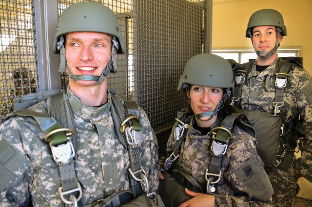 """Participants in the American Military Italian Civilian Integration initiative get an opportunity to experience firsthand a """"Day in the Life of Soldier."""" Three AMICI participants (left, Andrea Morsoletto, Francesca Zotto and Giulio Rigodanzo) join paratroopers from 173rd Airborne Brigade during Basic Airborne Refresher training at Caserma Ederle March 28, 2017."""