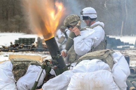 Soldiers from the 10th Mountain Division (Light Infantry), fire rounds down range using a M120 120mm mortar, into the impact zone during a mortar live fire exercise, on Fort Drum, N.Y., March 7, 2018.