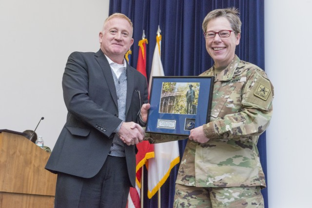Douglas A. Tamilio, director of the Natick Soldier Research, Development and Engineering Center, presents Maj. Gen. Tammy S. Smith with a plaque of appreciation. Smith visited NSRDEC on Mar. 20 and was the esteemed guest speaker at NSRDEC's Women's History Month celebration.