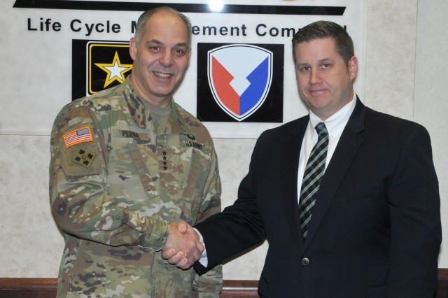 "AMC Commanding General Gen. Gustave ""Gus"" Perna presented a commander coin to TACOM ILSC employee Larry Ruehlen on March 23, 2018 for his contributions to supply availability."