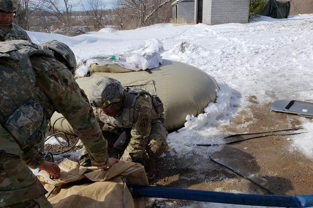 Soldiers from 543rd Composite Supply Company, 548th Combat Sustainment Support Battalion, 10th Mountain Division (LI) Sustainment Brigade, provide water support for 2nd Brigade Combat Team, 10th Mountain Division (LI), during the Mountain Peak training exercise at Fort Drum.