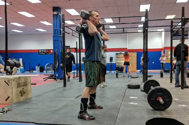 Steve Booth, an instructor at the Lt. Col. Dured E. Townsend Mission Training Complex at Fort Drum, participates in a CrossFit Open workout.