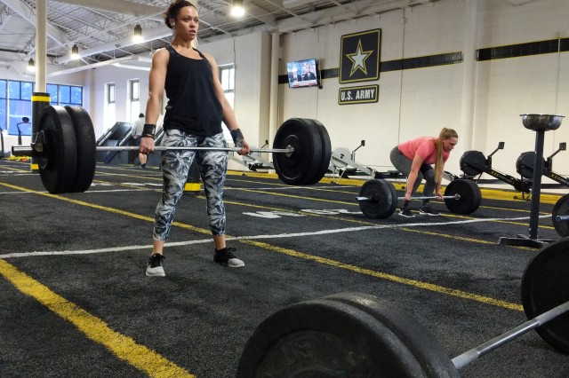 Heather Famiano, military spouse, was an avid runner and initially used CrossFit to train for marathons before fully committing herself to the training.