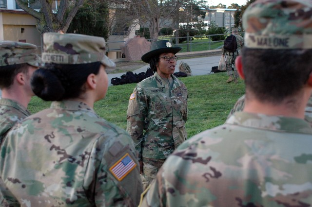 PRESIDIO OF MONTEREY, California -- Staff Sgt. Neika Thompson answers questions from a group of Company C, 229th Military Intelligence Battalion Soldiers after morning formation.