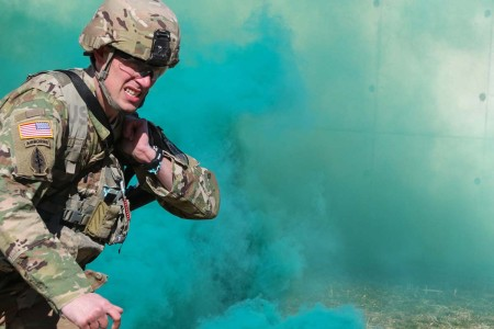A Soldier moves under the concealment of smoke with a loaded rescue system during the stress shoot part of the Maryland National Guard's Best Warrior Competition at Gunpowder Military Reservation in Glenn Arm, Md., March 16, 2018. Service members from the Maryland Army and Air National Guard, as well as the state partner nations of Bosnia-Herzegovina and Estonia, vie for the 2018 Best Warrior title.