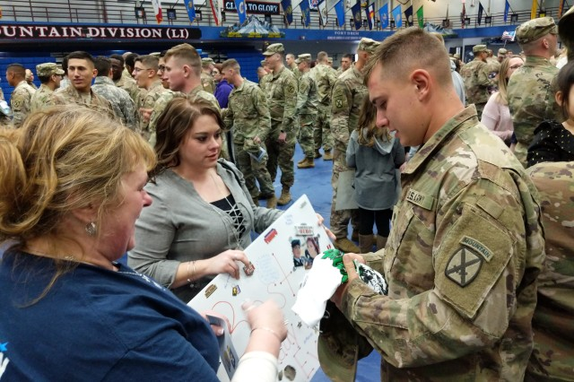 The 10th Mountain Division (LI) and Fort Drum community welcomed back about 100 1st Brigade Combat Team Soldiers -- mostly from B Company, 1st Battalion, 32nd Infantry Regiment -- from a six-month deployment in Africa during a redeployment ceremony March 23 at Magrath Sports Complex.