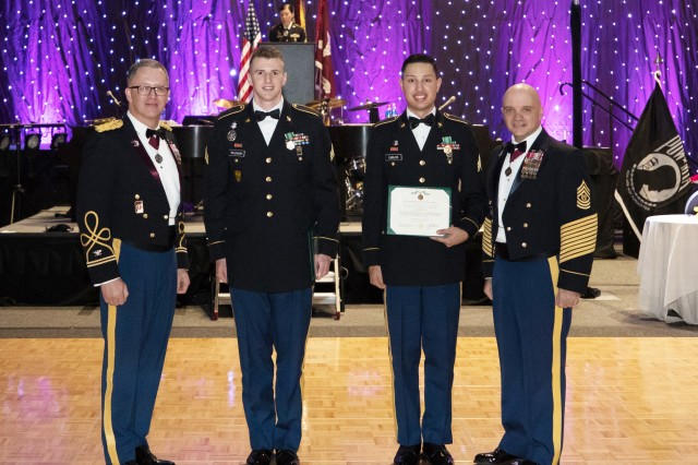 Sgt. Andrew Wildasin and Sgt. Abel Carlos (center) get recognized as Madigan's NCO of the Year and Soldier of the Year by Madigan Commander COL Michael Place and Command Sgt. Maj. Mark Bivins on Feb. 3 at the Madigan Winter Formal in Tacoma, Wash.