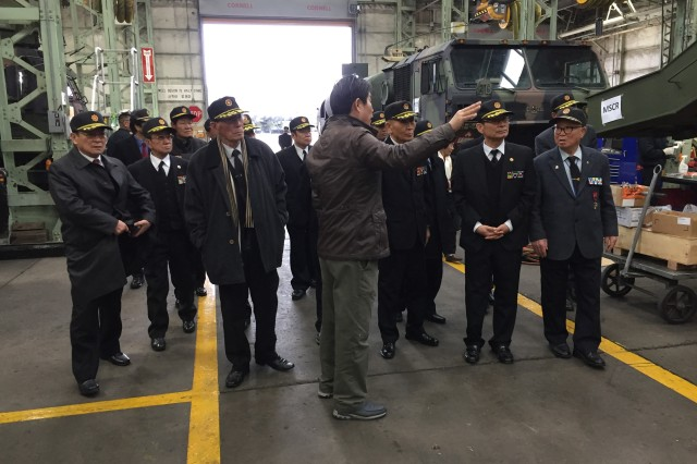 Mr. Yim, Jong-uk, Assistant Maintenance Manager of the Heavy Equipment Division, Materiel Support Command -- Korea briefs on the HED's mission to members of the Gyeongbuk Military Merit Awardee Association.