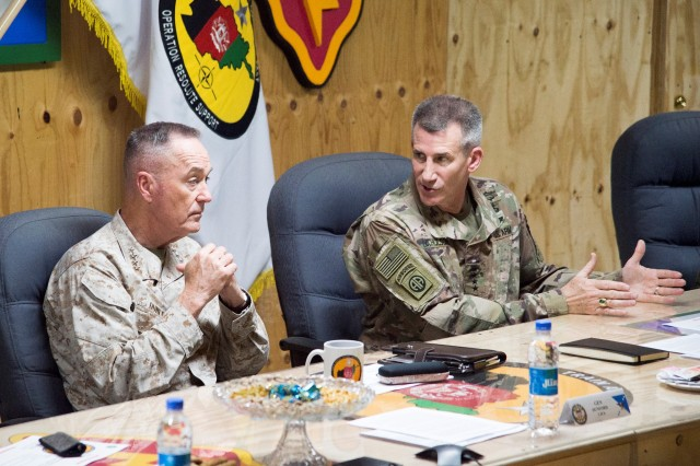 Marine Corps Gen. Joe Dunford, left, chairman of the Joint Chiefs of Staff, and Army Gen. John W. Nicholson Jr., commander of the Resolute Support mission and U.S. Forces Afghanistan, have a roundtable discussion with members of Train Advise Assist Command East at Forward Operating Base Gamberi, Afghanistan, March 21, 2018.