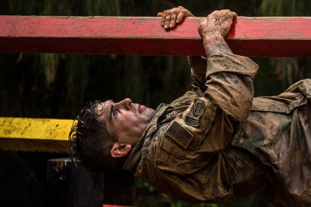 A Soldier assigned to the 2nd Infantry Brigade Combat Team, 25th Infantry Division, navigates the weaver obstacle at the Air Assault Obstacle Course on Schofield Barracks, Hawaii, Mar. 8, 2018. The Rangers had to go through the Air Assault Obstacle Course two times after completing a two and a half mile body-armor run and six-mile ruck march.
