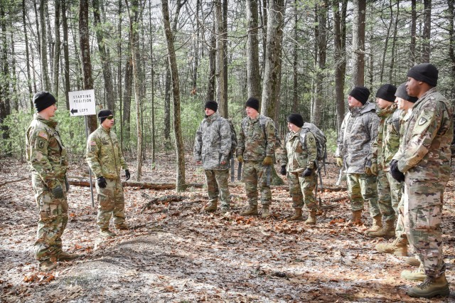 Human Research Volunteer Soldiers listen to Staff Sgt. Anthony Sandoval, the noncommissioned officer in charge of the Natick Soldier Research Development and Engineering Center's Headquarters Research Development Detachment, before conducting land navigation training at Fort Devens, Massachusetts in February 2018.