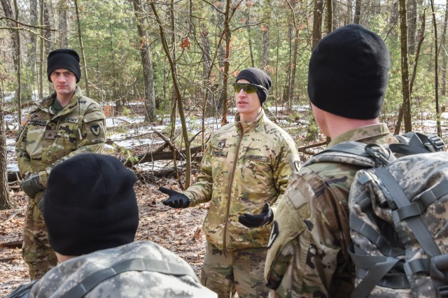 Staff Sgt. Anthony Sandoval, the noncommissioned officer in charge of the U.S. Army Natick Soldier Research Development and Engineering Center's Headquarters Research Development Detachment, talks to a group of Human Research Volunteer Soldiers during land navigation training at Fort Devens, Massachusetts in February 2018.