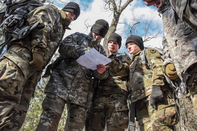 A group of Human Research Volunteer Soldiers from the U.S. Army Natick Soldier Research Development and Engineering Center's Headquarters Research and Development Detachment consult their map during land navigation training held at Ft. Devens, Massachusetts in February 2018.