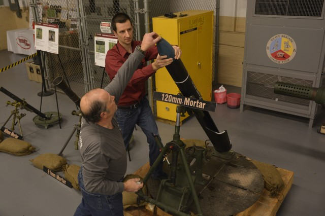 ARDEC-Benet Labs' George Hathaway, left, and Robert Facteau are testing the 120mm mortar training aid at the Watervliet Arsenal.