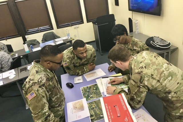 Soldiers from the 773d Civil Support Team, 361st Civil Affairs Brigade, review the training plan for Airmen from 48th Civil Engineer Squadron, 48th Mission Support Group, during a Chemical, Biological, Radiological and Nuclear exercise coordinated by Defense Threat Reduction Agency Europe at Stanford Training Area, Norfolk, England, March 8, 2018. (Courtesy Photo)