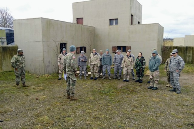 Soldiers from the 773d Civil Support Team, 361st Civil Affairs Brigade, instruct Airmen from 48th Civil Engineer Squadron, 48th Mission Support Group, on gathering sensitive information from clandestine labs during a Chemical, Biological, Radiation and Nuclear training exercise coordinated by Defense Threat Reduction Agency Europe at Stanford Training Area, Norfolk, England, March 8, 2018. (Courtesy Photo)
