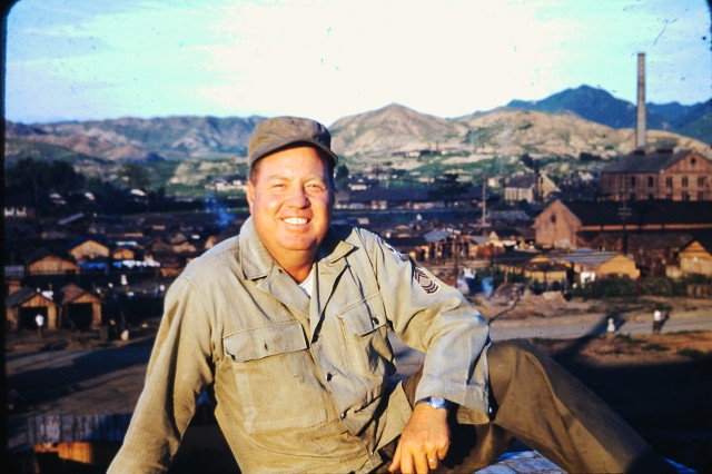 During the Korean War, Master Sgt. Thomas Benton Hutton, a Soldier serving with the Eighth Army in Korea, poses for a photo. Hutton himself took many photos of Korea during the war and left behind well over 200 color slides that show Korea and its people as they looked more than six decades ago. Hutton served during the war as a First Sergeant with the 91st Ordnance Medium Automotive Maintenance Company. He died in 1988. His grandson, Col. Brandon D. Newton, who serves in Korea as Commander, U.S. Army Garrison Red Cloud and Area I, has donated his grandfather's Korean War slides to the South Korean Army. He hopes they'll be a help to historical researchers. The Korean army plans a ceremony later this spring at its Daejon headquarters to formally mark donation of the slides.