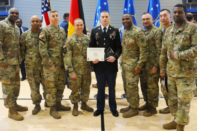 U.S. Army Staff Sgt. Jacob Rau poses with senior leaders from 21st Special Troops Battalion and 21st Theater Sustainment Command after the U.S Air Forces in Europe Kislinger NCO academy graduation ceremony at Ramstein Air Base, Friday, March 23, 2018. Rau was the first 21st TSC NCO to graduate from the Kislinger NCO academy.