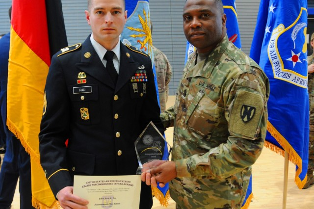 U.S. Army Staff Sgt. Jacob Rau, left, 21st Special Troops Battalion, 21st Theater Sustainment Command mortuary affairs non-commissioned officer, poses with Command Sgt. Maj Defarreo Poole, 21st Special Troops Battalion at the U.S. Air Forces in Europe Kisling NCO academy graduation ceremony at Ramstein Air Base, Germany, March 23, 2018. Rau was the first 21st TSC Soldier to attend and graduate from the academy.
