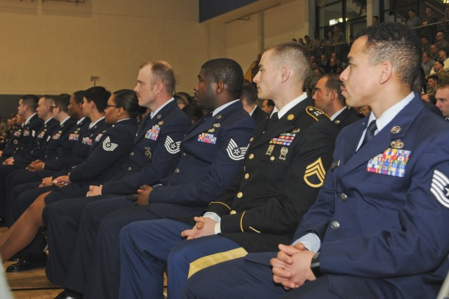 U.S. Army Staff Sgt. Jacob Rau, left, 21st Special Troops Battalion, 21st Theater Sustainment Command mortuary affairs non-commissioned officer sits with his U.S. Air Forces in Europe Kislinger NCO academy Eagle flight at the academy's graduation ceremony at Ramstein Air Base, Germany, March 23, 2018. Rau was the first 21st TSC NCO to attend and graduate from Kislinger NCO academy.