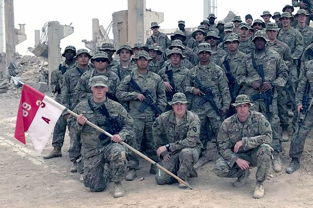 1st Sgt. Joshua Ward, front row kneeling on the right, is now assigned to the 3rd Brigade Combat Team, 10th Mountain Division (A Troop, 3-89 CAV).   This picture was taken in Iraq earlier this year.