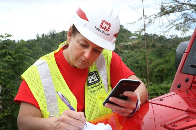 Project manager Cynthia Kitchens, U.S. Army Corps of Engineers, Tulsa District, works in Corozal, Puerto Rico, as a Quality Assurance Specialist for Task Force Power Restoration March 24, 2018.  Kitchens, like hundreds of other USACE employees, volunteered to leave her home duty station to work a temporary duty assignment restoring power for the citizens of Puerto Rico.  The power grid in Puerto Rico has 2,400 miles of transmission lines across the island and 30,000 miles of distribution lines with 300 sub-stations. It is estimated that 80 percent of the grid was damaged when Hurricane Maria struck the island on Sept. 20, 2017. (Released/U.S. Army Corps of Engineers photo by: Preston L. Chasteen)