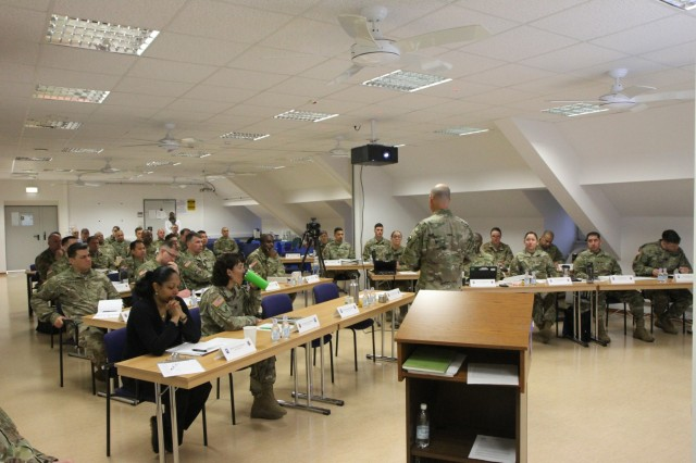 Soldiers from the 361st Civil Affairs Brigade (361st CA BDE) listen as Col. Bradley Heston (not picured), brigade commander of 361st CA BDE, gives his opening remarks at the 361st CA BDE's Commander's Conference in Kaiserslautern, Germany, Mar. 22, 2018. (US Army Reserve photo by Pfc. Maximilian Huth.)