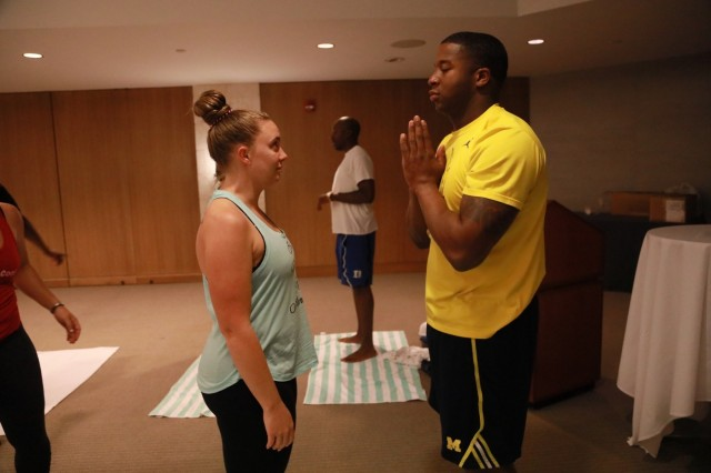 "Ashley and Quentin Barnett, married for seven years, participate in couples yoga at the United States Army Pacific Strong Bonds retreat March 25, 2018 in Honolulu.""This weekend we really felt like this USARPAC retreat cared about us feeling connected as a couple,"" said Barnett, a Staff Sgt. and master driver at USARPAC. ""It wasn't just seminars or class room power points. There was a lot more focus on interaction and applying what we learned. I loved the couple's yoga. That was a cool way for us to connect with each other."""