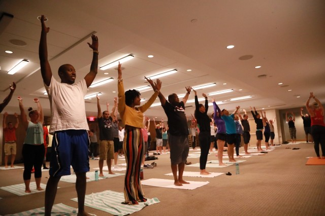 Soldiers and their spouses participate in couples yoga at the United States Army Pacific Strong Bonds retreat March 25, 2018 in Honolulu.