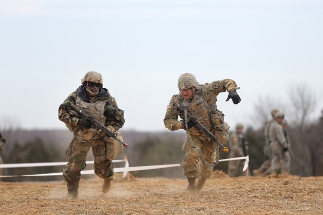 U.S. Army Reserve Soldiers, assigned to the 301st Maneuver Enhancement Brigade, conduct three-to-five second buddy rushes as part of their reacting to direct fire training, ahead of their lanes training validation, during Combat Support Training Exercise 78-18-03, at Fort Knox, Kentucky, Mar. 19, 2018. CSTX 78-18-03 ensures that America's Army Reserve units and Soldiers are trained and ready to deploy on short-notice and bring capable, combat-ready, and lethal firepower in support of the Army and our joint partners anywhere in the world. (U.S. Army Reserve photo by Anthony L. Taylor)