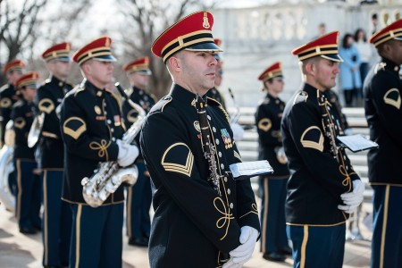 The U.S. Army Band (Pershing's Own), supports a full honors wreath laying ceremony hosted by Gen. François Lecointre, chief of defence staff, French Armed Forces, at the Tomb of the Unknown Soldier, Arlington National Cemetery, Arlington, Va., Feb. 12, 2018. Lecointre visited ANC as part of his first official visit, touring the Memorial Amphitheater Display Room and meeting with ANC Senior Leadership.