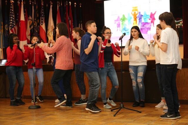Students from Zama American Middle-High School Drama and Chorus Class sing a song to highlight several American women's achievements during Women's History Month Observance held March 23, 2018 in the Camp Zama Community Club. (U.S. Army photo by Noriko Kudo)