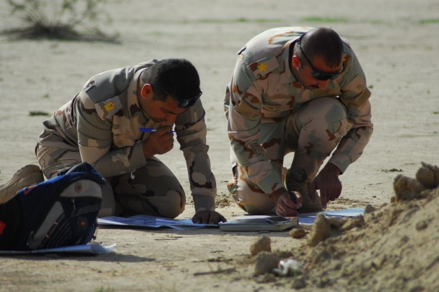 Iraqi Army students plot grid coordinates on a map, which they will use to instruct pilots assigned to the 7th Battalion, 17th Cavalry Regiment, 449th Combat Aviation Brigade, to simulate a close combat attack, involving an attack helicopter maneuvering and firing in direct support of a ground force coming into direct contact with the enemy during the Iraq Forward Air Control Course live-fire training exercise March 8, 2018 in Besmaya, Iraq.