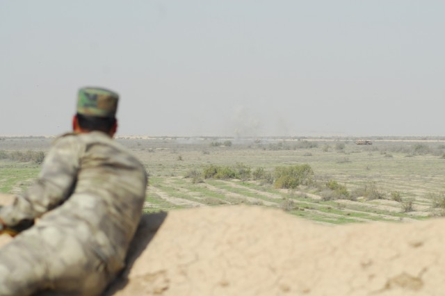 An Iraqi Army student observes the destruction of enemy forces in a simulated close combat attack after successfully instructing pilots assigned to the 7th Battalion, 17th Cavalry Regiment, 449th Combat Aviation Brigade on movement to contact, during the Iraqi forward air control course live-fire training exercise March 8, 2018 in Besmaya, Iraq.