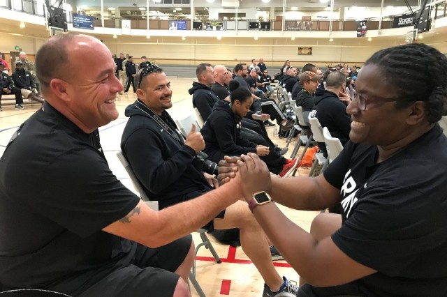 Retired U.S. Army Sgt. Charles Mays and Retired U.S. Army Maj. Dr. Lisa Maddox greet each other during a medal ceremony at the 2018 Army Trials at Fort Bliss, Texas.
