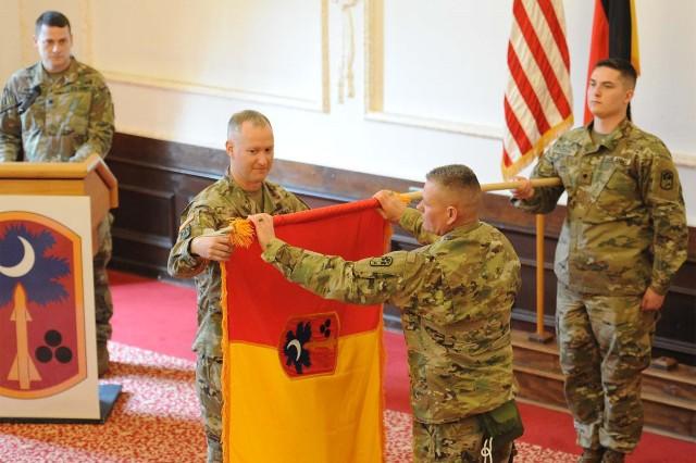 ANSBACH, Germany -- U.S. Army Colonel Richard A. Wholey, Jr, commander of the 678th Air Defense Brigade (678th ADA), South Carolina National Guard and Command Sgt. Maj. Anthony P. Collins, brigade command sergeant major of the 678th Air Defense Brigade uncase the colors of the 678th during a ceremony in the U.S. Army Garrison Ansbach (USAG Ansbach), Von Steuben Community Center March 27, 2018. The ceremony commemorated the beginning of the brigade's deployment in Europe in support of U.S. Army Europe (USAREUR) Operation Atlantic Resolve.To learn more about the people and facilities of the U.S. Army Garrison Ansbach (USAG Ansbach) and the people they support in Ansbach, Katterbach and Illesheim, visit the community website at http://ansbach.army.mil