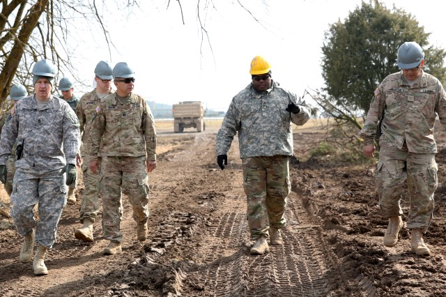 U.S. Army Soldiers with the Army Reserve's 377th FEST -- A, inspect a construction project that the 922nd Engineer Company (Horizontal), Louisiana Army National Guard, is working on at the Joint Multinational Readiness Center's Hohenfels Training Area, Hohenfels, Germany, March 24, 2018. The Army Reserve 377th FEST-A and other Army National Guard units are conducting their annual training in Germany and helping U.S. Army Europe's premiere combat training center with some much needed projects throughout the training area.