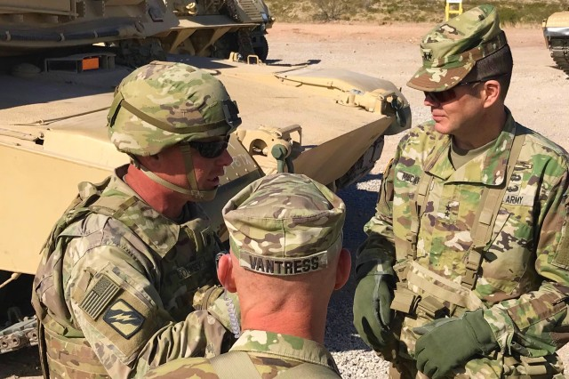 Col. Jack E. Vantress (left), commander, 177th Armored Brigade and Maj. Gen. Todd McCaffrey, commanding general, First Army Division East, speak with Mississippi Army National Guard Lt. Col. Christopher Cooksey, commander, 2nd Battalion, 198th Armor, 155th Armored Brigade Combat Team, during a site visit to Range 50, March 27. Cooksey and his team are based out of Senatobia, Kansas, and will partner with the First Army OC/T Soldiers from 2nd Battalion, 351st Infantry Regiment, during their mobilization exercise at Fort Bliss, Texas.
