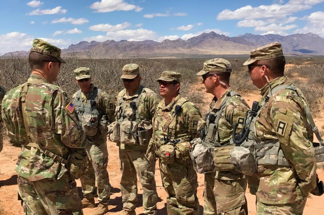 Soldiers from First Army's 2nd Battalion, 305th Field Artillery and 2nd Battalion, 307th Field Artillery provide an overview of training objectives to Maj. Gen. Todd McCaffrey, commanding general, First Army Division East, at Fort Bliss, Texas, March 27. The First Army OC/Ts will validate the Mississippi Army National Guard's 2nd Battalion, 114th Field Artillery, based out of Starkville, Miss., as part of the 155th Armored Brigade Combat Teams mobilization exercise.