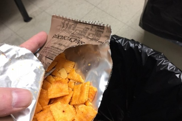 A minor defect noted with significant damage found to cheese crackers in the ration.