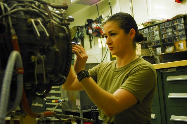 U.S. Army 1st Battalion, 126 Aviation Regiment (General Support Aviation Battalion) aircraft powerplant repairer Spc Kathleen Scanlon, uses a torque wrench to secure the bolts of a stage one nozzle onto a UH-60 Black Hawk engine in a maintenance shop at Camp Taji, Iraq March 23, 2018. Aircraft powerplant repairers supervise, inspect and perform maintenance on aircraft turbine engines and components ensuring airplanes and helicopters are safe and ready to fly.