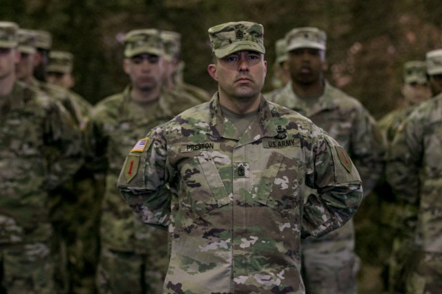 Sgt. Maj. Terry Preston stands in front of a formation of 1st Infantry Division Soldiers during a transfer of authority ceremony held in Poznan, Poland, Feb. 28, 2018.