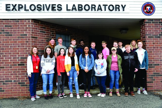 McAlester High School senior participating in Eastern Oklahoma State College's GEAR UP program, along with Rachael Ranallo (far left), GEAR UP education coordinator for EOSC, pose for a group photograph following a brief tour of McAlester Army Ammunition Plant, Okla., on March 27.